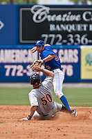 April 25 2010: Josh Satin (3) of the St. Lucie Mets turns a Double play during the game vs. the Bradenton Marauders at Digital Domain Park in Port St. Lucie, Florida. St. Lucie, the Florida State League High-A affiliate of the New York Mets, won the game against Bradenton, affiliate of the Pittsburgh Pirates, by the score of 5-4  Photo By Scott Jontes/Four Seam Images