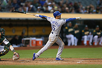OAKLAND, CA - AUGUST 14:  Whit Merrifield #15 of the Kansas City Royals bats against the Oakland Athletics during the game at the Oakland Coliseum on Monday, August 14, 2017 in Oakland, California. (Photo by Brad Mangin)