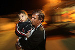 Ahmad Hamed, a Palestinian boy from Gaza is seen carried by Kassem Ouda, after passing through the Erez Crossing from Gaza to Israel, Thursday 28th, 2009. Ouda, an Israeli citizen, will be  hosting Ahmad in his home in the city of Haifa, for the next two weeks, as part of a program to help Palestinian children who were orphaned during the Gaza war to continue their lives. ..Photo by : Elyahu Ben Yigal / JINI