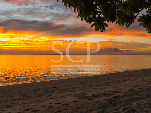 Flic en Flac, Mauritius. La Pirogue tourist resort. Golden sunset.
