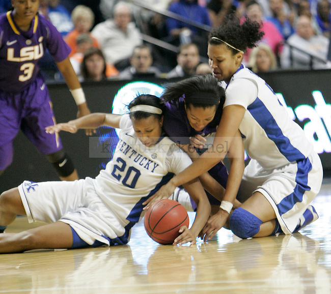Players fight for the ball during the SEC Women's Basketball Tournament game UK Hoops vs. LSU at Bridgestone Arena in Nashville, Tenn., on Saturday, Mar. 3, 2012. Photo by Tessa Lighty | Staff