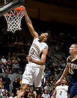 Allen Crabbe of California dunks the ball into a basket during the game against San Diego at Haas Pavilion in Berkeley, California on November 1st, 2011.  California defeated San Diego, 88-53.