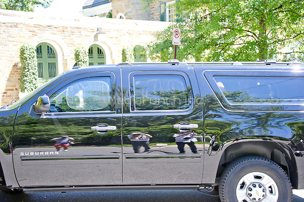 Photographers are reflected in the side of a Chevy Suburban, perhaps with former United States Secretary of State Hillary Clinton aboard, that returns to the Clinton residence in Washington, DC on Saturday, July 2, 2016.   It is believed the former Secretary was questioned by the FBI today in relation to her personal e-mail server that is the center of controversy.<br /> Credit: Ron Sachs / CNP<br /> (RESTRICTION: NO New York or New Jersey Newspapers or newspapers within a 75 mile radius of New York City)/MediaPunch