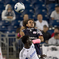 New England Revolution defender Kevin Alston (30) heads the ball away from San Jose Earthquakes midfielder Simon Dawkins (10). In a Major League Soccer (MLS) match, the San Jose Earthquakes defeated the New England Revolution, 2-1, at Gillette Stadium on October 8, 2011.