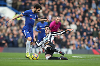 Mikel Merino of Newcastle United dives in on Cesc Fabregas of Chelsea during the Premier League match between Chelsea and Newcastle United at Stamford Bridge, London, England on 2 December 2017. Photo by David Horn.