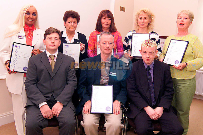 Reciepents of the Pitman Training Certificate. Pictured are back row L/R, Mary Farrell, Rita Corrigan, Jackie Matthews, Audrey Harmon and Bernie Moore. Front Row L/R, Mark Markey, owner Pitman Training, Peter Nulty and Mark Brady, trainer..Picture: Paul Mohan/Newsfile