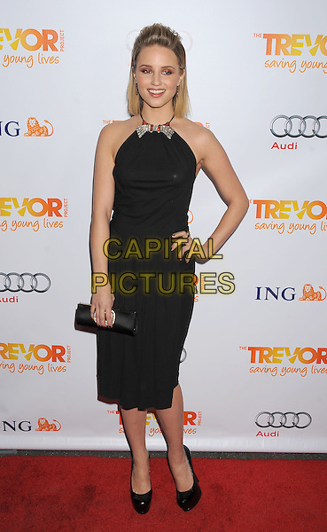 Dianna Agron.Trevor Live at The Hollywood Palladium in Hollywood, California, USA..December 4th, 2011.full length dress black sleeveless halterneck diamonds silver bow collar detail clutch bag hand on hip.CAP/ROT/TM.©Tony Michaels/Roth Stock/Capital Pictures