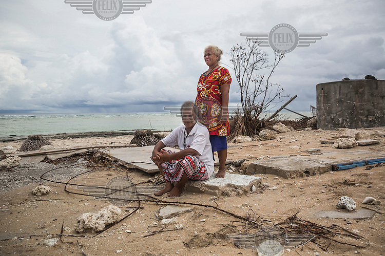 Geuati Lutelu, 60, and his wife Elipope, 54, from Nui Island, sit in front of the remains of their house that was completely destroyed by Cyclone Pam in March 2015. Geuati says: 'Everything was destroyed, we couldn't find anything, we took only two suitcases before the cyclone came and then we took shelter. We've seen 2-3 metre  high waves, but still hoped that our house would be fine. Next day when we came to see it, we were shocked. My kids left Nui and live now in Funafuti. There is nothing left for them. I'm afraid to build a new house, because one day it can be destroyed by waves  again.'