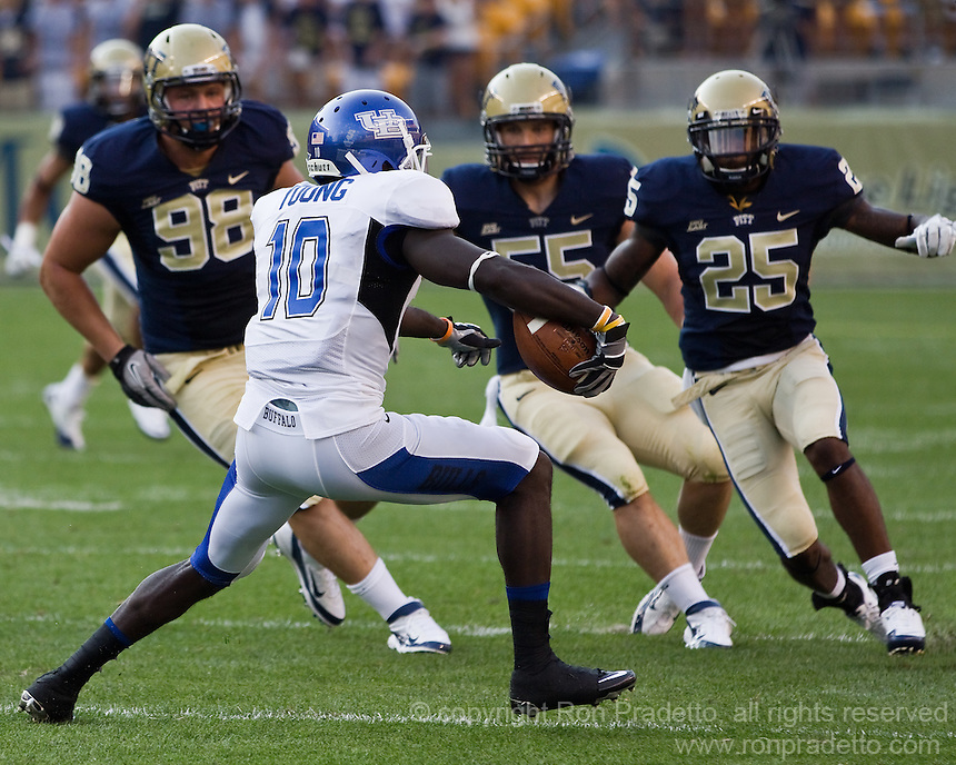 Pitt defensive tackle Chas Alecxih (98), defensive linebacker Max Gruder (55) and defensive back Jason Hendricks (25) close in on Bulls wide receiver Ed Young (10.)  The Pittsburgh Panthers beat the Buffalo Bulls 35-16 at Heinz field in Pittsburgh, Pennsylvania on September 3, 2011