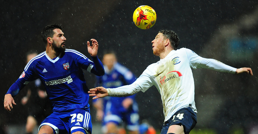 Preston North End's Joe Garner vies for possession with Brentford's Yoann Barbet<br /> <br /> Photographer Chris Vaughan/CameraSport<br /> <br /> Football - The Football League Sky Bet Championship - Preston North End v Brentford - Saturday 23rd January 2016 -  Deepdale - Preston<br /> <br /> &copy; CameraSport - 43 Linden Ave. Countesthorpe. Leicester. England. LE8 5PG - Tel: +44 (0) 116 277 4147 - admin@camerasport.com - www.camerasport.com