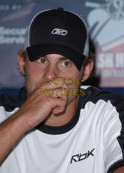 ANDY RODDICK.Attends the 12th Annual World Team Tennis Smash Hits Press Conference benefiting The Elton John AIDS Foundation held at The Bren Events Center at UC Irvine in Irvine, California on October 11th 2004..portrait headshot cap sniffing.Ref: DVS.www.capitalpictures.com.sales@capitalpictures.com.©Debbie VanStory/Capital Pictures .