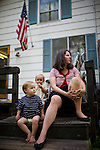 Sharon Ferrell, right, relaxes with her son James, left, and Ivy, center, at their home in Lincoln, CA May 13, 2009.