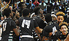 Elmont teammates celebrate after their 55-51 double overtime win over South Side in the Nassau County varsity boys basketball Class A final at LIU Post on Saturday, Feb. 27, 2016.