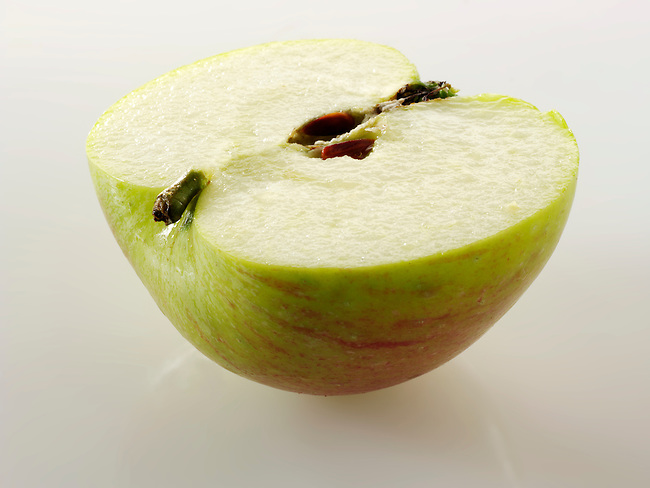 Fresh cut half of a Bramley Apple