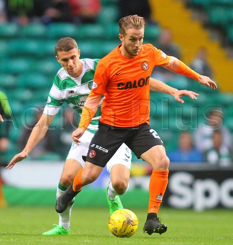 25.10.2015. Glasgow, Scotland. Scottish Premier League. Celtic versus Dundee United. Jozo Simunovic challenges Aaron Kuhl