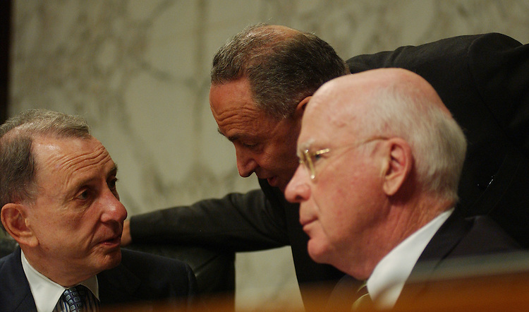 WASHINGTON - July 24: Chairman Patrick J. Leahy, D-Vt., Sen. Charles Schumer, D-N.Y., and ranking Republican Arlen Specter, discussing Attorney General Alberto R. Gonzales during the Senate Judiciary Committee hearing. Democrats on the committee, along with the panel's ranking Republican, Arlen Specter of Pennsylvania, questioned Gonzales bluntly about the hospital trip, the firings of nine U.S. attorneys last year, and other matters. Gonzales enjoys little credibility with the committee and his answers did nothing to rehabilitate his standing. President Bush has asserted executive privilege over White House documents, and the testimony of current and former White House officials, on the U.S. attorney firings. The House Judiciary Committee is moving to respond with contempt of Congress citations against the White House and former White House counsel Harriet Miers. The Senate committee might soon take similar action. But Gonzales declined to answer queries from senators about the administration's apparent unwillingness to allow the U.S. attorney for the District of Columbia to take a contempt of Congress citation before a grand jury, as called for under federal law. Gonzales is recused from Justice Department matters involving the federal prosecutor firings. (Photo by Dana Statton/Congressional Quarterly)..
