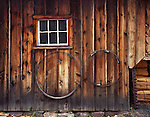 Delaware Water Gap National Recreation Area, NJ<br /> Weathered board and batten siding with white window and wagon wheel rims