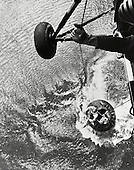 In Atlantic Ocean - (FILE) -- A United States Marine helicopter recovery team hoists astronaut Alan Shepard from his Mercury spacecraft after a successful flight and splashdown in the Atlantic Ocean. On Friday, May 5th 1961, Alan B. Shepard Jr. became the first American to fly into space. His Freedom 7 Mercury capsule flew a suborbital trajectory lasting 15 minutes 22 seconds. His spacecraft landed in the Atlantic Ocean where he and his capsule were recovered by helicopter and transported to the awaiting aircraft carrier U.S.S. Lake Champlain..Credit: NASA via CNP