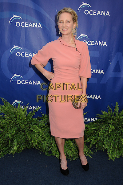 Anne Heche<br /> 6th Annual Oceana SeaChange Gala held at a Private Villa, Laguna Beach, California, USA. <br /> August 18th, 2013<br /> full length pink dress clutch bag gold black shoes hand on hip<br /> CAP/ADM/BP<br /> &copy;Byron Purvis/AdMedia/Capital Pictures