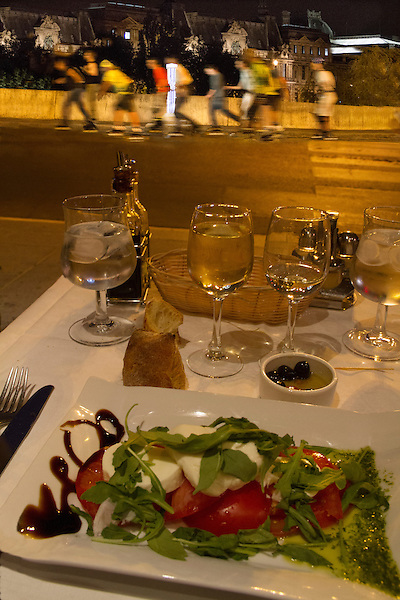 Dinner and roller bladers on a Paris street, France,