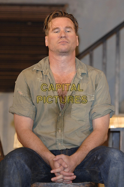 "VAL KILMER.""The Postman Always Rings Twice"" production photocall.The Playhouse Theatre.London 31 May 2005..half length dirty sweaty hairy chest green shirt open play costume stage.www.capitalpictures.com.sales@capitalpictures.com.©Capital Pictures"