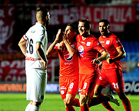 CALI - COLOMBIA, 10- 03-2019: Cristian Álvarez de América de Cali celebra con sus compañeros de equipo el gol anotado a Once Caldas, durante partido entre América de Cali y Once Caldas, de la fecha 9 por la Liga Águila I 2019 jugado en el estadio Pascual Guerrero de la ciudad de Cali. / Cristian Alvarez of America de Cali celebrates with his teammates the scored goal to Once Caldas, during a match between America de Cali and Once Caldas, of the 9th date for the Aguila Leguaje I 2019 at the Pascual Guerrero stadium in Cali city. Photo: VizzorImage / Nelson Ríos / Cont.