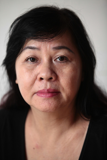 "Phung Huynh Thi, 63, worked from 1967 to 1972 as a PX cashier at the U.S. Special Forces camp in Nha Trang, Vietnam. After the war ended in 1975, she discovered that her father -- whom she thought was dead  -- had been serving with the Viet Cong. ""I never knew my father was VC,"" she says. ""My mother never told me."" Wanting to join her sister, who had married a Special Forces officer and moved to Washington state, she tried to flee the country on three separate occasions, but she was caught each time, imprisoned and interrogated. ""Everyday, they would come and ask me the same questions,"" she recalls. ""But I never told them I worked for the Americans.""  Married since 2009 to a New Zealand citizen, she says she no longer dreams of leaving. ""Now I think to stay in Vietnam is better for me,"" she says. ""Now I'm too old to go. Now I have a good man.""  July 18, 2011."