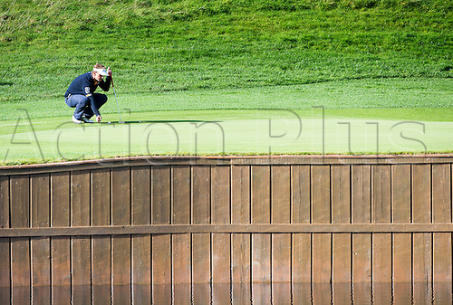 19.10.2014. The London Golf Club, Ash, England. The Volvo World Match Play Golf Championship.  Day 5 semi final matches.  Joost Luiten [NED] lines up a putt on the 14th in his match against Mikko Ilonen [FIN].  Mikko Ilonen [FIN] won 2 and 1.