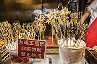 Cooked bugs on skewers for sale, ready to be eaten in Beijing, China