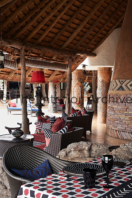 A dining table on a covered terrace at Singita Pamushana Lodge, Malilongwe Trust, Zimbabwe