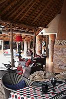 A dining table on a covered terrace at Singita Pamushana Lodge, Malilongwe Trust, Zimbabwe