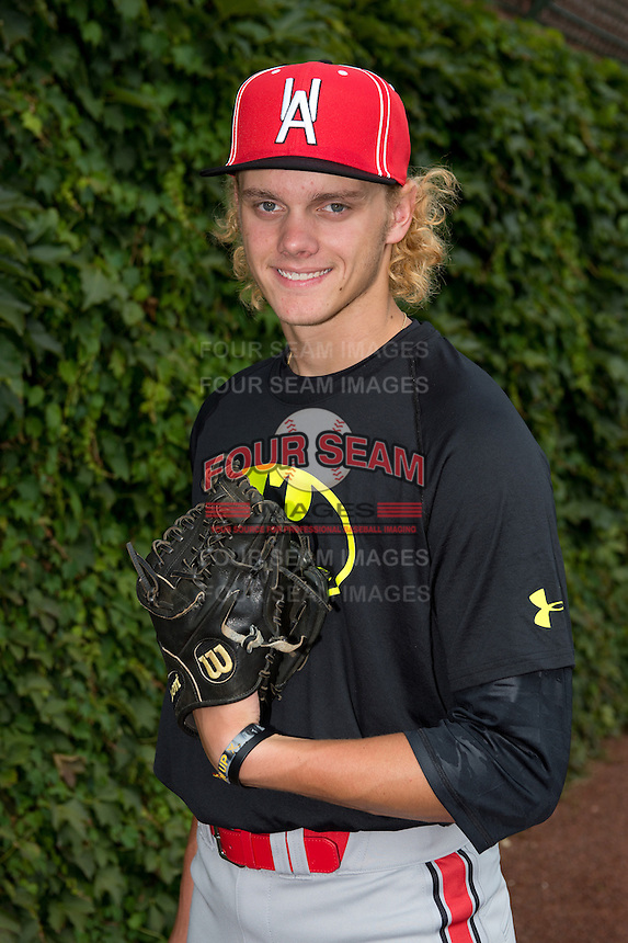 Ashe Russell (35) of Cathedral High School in Indianapolis, Indiana poses for a photo during practice before the Under Armour All-American Game on August 16, 2014 at Wrigley Field in Chicago, Illinois.  (Mike Janes/Four Seam Images)