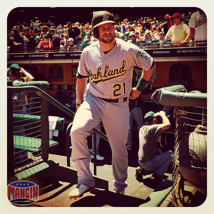 SAN FRANCISCO, CA - JULY 10: Instagram of Stephen Vogt of the Oakland Athletics getting ready in the dugout before a game against the San Francisco Giants at AT&T Park on July 10, 2014 in San Francisco, California. Photo by Brad Mangin