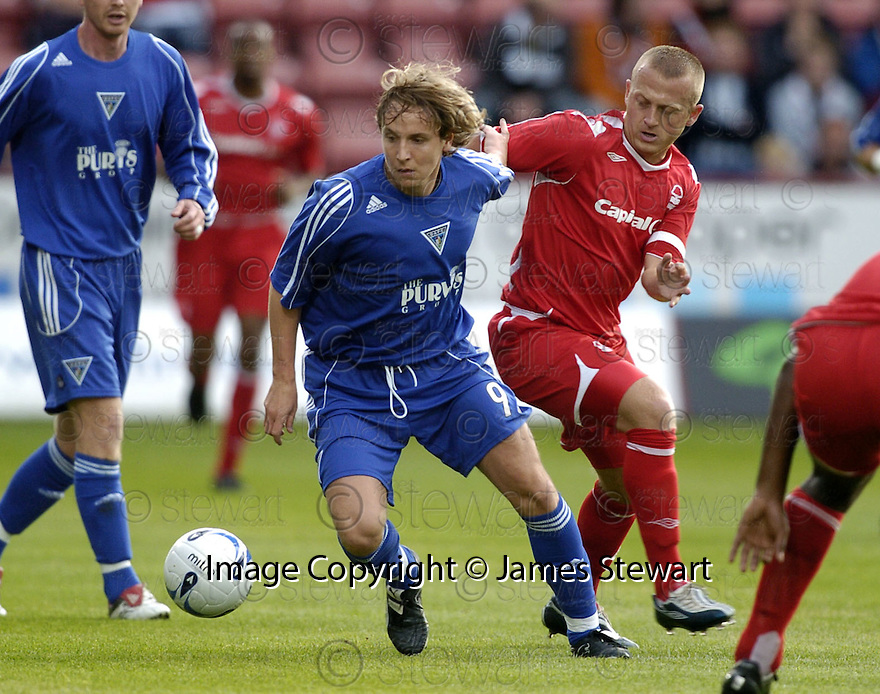 26/07/2007       Copyright Pic: James Stewart.File Name : sct_jspa06_dunfermline_v_notts_forest.TAM MCMANUS MAKES HIS WAY THROUGH THE FOREST DEFENCE......James Stewart Photo Agency 19 Carronlea Drive, Falkirk. FK2 8DN      Vat Reg No. 607 6932 25.Office     : +44 (0)1324 570906     .Mobile   : +44 (0)7721 416997.Fax         : +44 (0)1324 570906.E-mail  :  jim@jspa.co.uk.If you require further information then contact Jim Stewart on any of the numbers above.........