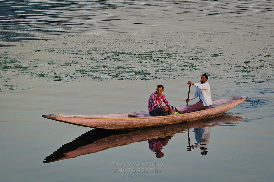 Muslim men on a Shikara, or gondola boat, on Dal Lake, Srinagar, Kashmir, India.
