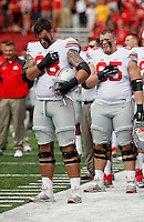 Ohio State Buckeyes offensive lineman Taylor Decker (68) places his hand over his heart while the National Anthem plays before the quarter of their game at Byrd Stadium in College Park, Maryland on October 4, 2014. (Columbus Dispatch photo by Brooke LaValley)
