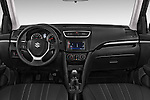 Stock photo of straight dashboard view of a 2013 Suzuki SWIFT Grand Luxe @ttraction 5 Door Hatchback 2WD Dashboard