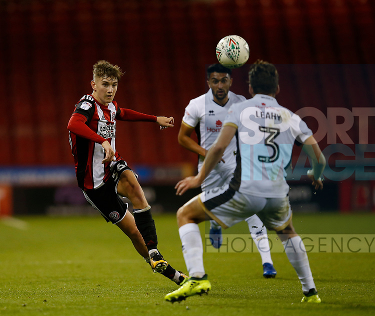 David Brooks of Sheffield Utd chips the ball over Luke Leahy of Walsall during the Carabao Cup First Round match at Bramall Lane Stadium, Sheffield. Picture date: August 9th 2017. Pic credit should read: Simon Bellis/Sportimage