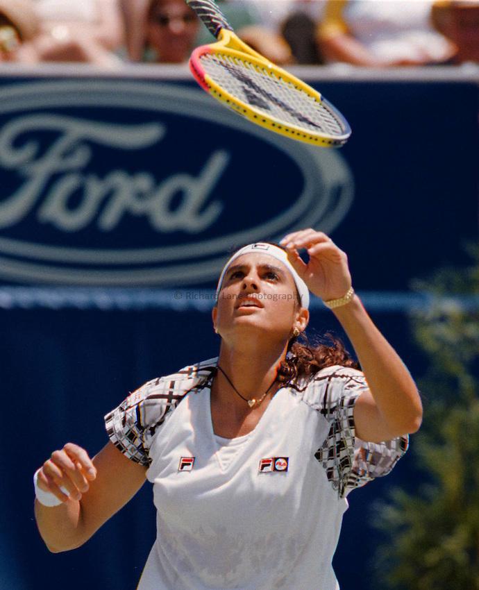 Photo. Abbey Wells.Austrailan Open, Melbourne, Austraila, 1996.Gabriela Sabatini throws her racket.
