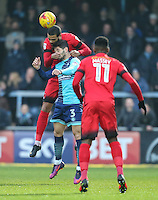 Paul McCallum of Leyton Orient (10) beats Joe Jacobson of Wycombe Wanderers  in the air as Gavin Massey of Leyton Orient (11) looks on during the Sky Bet League 2 match between Wycombe Wanderers and Leyton Orient at Adams Park, High Wycombe, England on 17 December 2016. Photo by David Horn / PRiME Media Images.