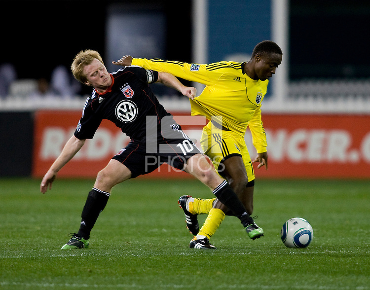 Dax McCarty (10) of D.C. United fights for the ball with Dilly Duka (11) of the Columbus Crew during the home opener at RFK Stadium in Washington D.C.  D.C. United defeated the Columbus Crew, 3-1.