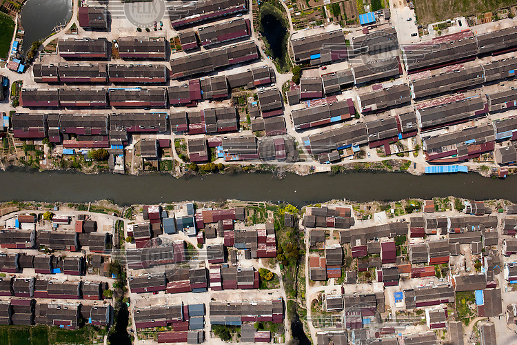 A canal divides low rise housing estates in the Jingangzhen district. /Felix Features