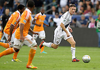 CARSON, CA - DECEMBER 01, 2012:   Robbie Keane (7) of the Los Angeles Galaxy gets away from the Houston Dynamo defense during the 2012 MLS Cup at the Home Depot Center, in Carson, California on December 01, 2012. The Galaxy won 3-1.
