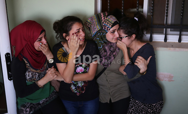 Palestinian women mourn during the funeral of Palestinian youth Laith al-Khaldi near the West Bank city of Ramallah August 1, 2015. Al-Khaldi died on Saturday at a West Bank hospital following a clash with Israeli troops near Ramallah, Palestinian hospital officials said. The confrontation was one of three in a matter of hours in which Palestinians died from Israeli-Palestinian violence on one of the most tense days in the occupied West Bank and the Gaza Strip in recent months. Israeli soldiers fired at the Palestinian after he threw a fire-bomb at them, the military said. Photo by Shadi Hatem