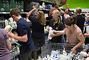 08/08/15<br /> <br /> Full story here:  http://www.fstoppress.com/articles/milk_protest_uttoxeter/<br /> <br /> Farmers and their families follow a coffin into Asda's Uttoxeter store before 'milking' the store in protest at low milk prices. 'Milking' is where dairy products are repositioned to aisles where water is normally sold.<br /> <br /> All Rights Reserved - F Stop Press.  www.fstoppress.com. Tel: +44 (0)1335 418629 +44(0)7765 242650
