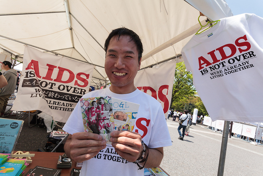 A man at a stand that helps people live with HIV and AIDS at The Rainbow Pride Event in Yoyogi Park, Shibuya, Tokyo, Japan. Sunday, April 26th 2015. This is the forth annual celebration of LGBT issues in Tokyo and forms part of a wider Rainbow Week. About 5% of the Japanese population identify as homosexual and this event hopes to foster a society where they can live equally and without prejudice.