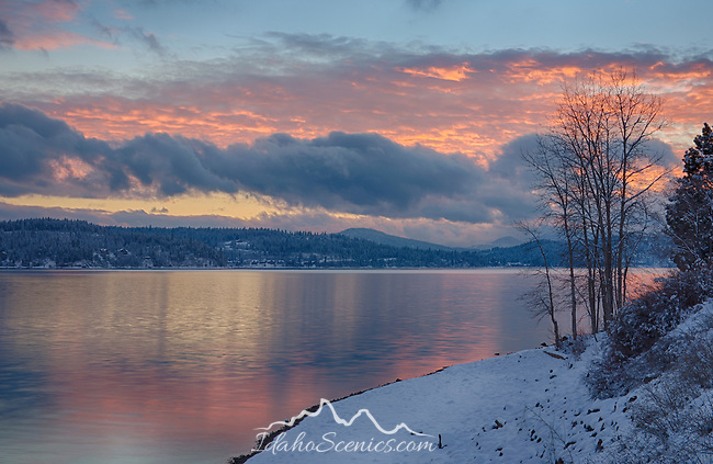 Idaho, North, Coeur d'Alene. Pink skies reflect in the calm evening waters.
