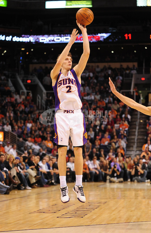 Dec. 15, 2009; Phoenix, AZ, USA; Phoenix Suns guard (2) Goran Dragic shoots a three point shot against the San Antonio Spurs at the US Airways Center. The Suns defeated the Spurs 116-104. Mandatory Credit: Mark J. Rebilas-