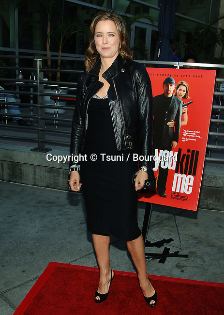 Tea Leoni arriving at the YOU KILL ME  Premiere at the Arclight Theatre in Los Angeles.<br /> <br /> full length<br /> eye contact