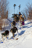 Sebastian Schnuelle runs down the river bank onto the Innoko River just prior to the ghost-town checkpoint of  Iditarod during the 2011 Iditarod race.